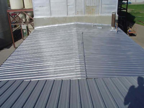 Restoration Of Metal Roof With Aluminum Poymer Spray
