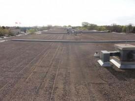 Tar and Gravel Reroofing for Flat Roof's in Winnipeg, Manitoba & Saskatewan